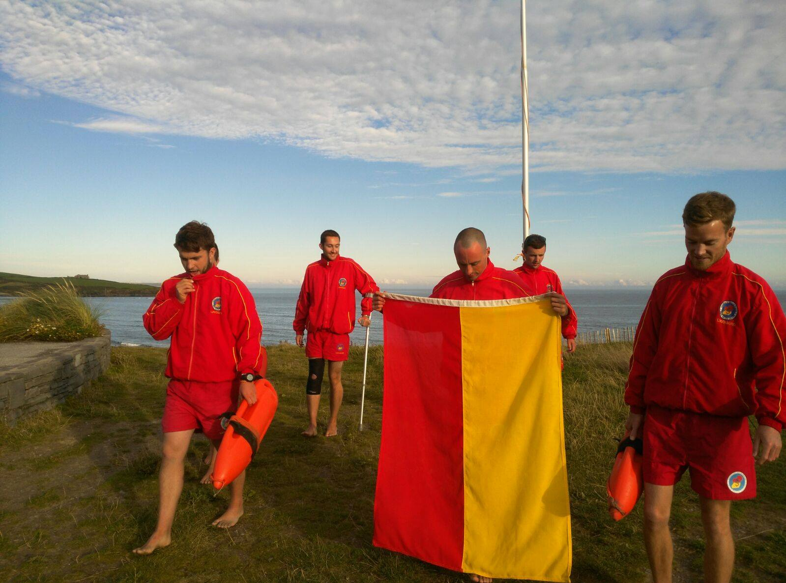 The Lifeguard team on Inchydoney Beach just after lowering their flag for the last time.